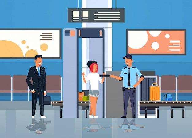 Police officer checking passengers and luggage at metal detector x-ray gate full body scanner airport security check department terminal interior