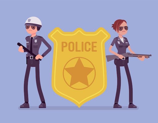 警察官のエンブレムと警官
