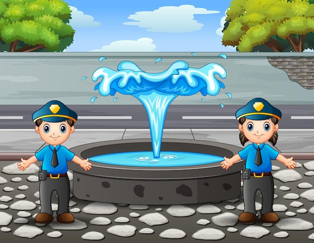 The police officer standing near the fountain