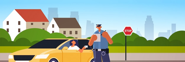 Police officer writing report parking fine or speeding ticket for woman sitting in car showing driver license road traffic safety regulations concept cityscape background portrait