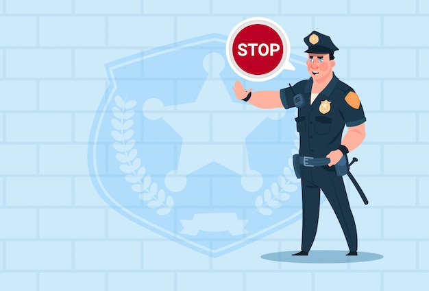 Policeman with stop chat bubble wearing uniform cop guard over brick background