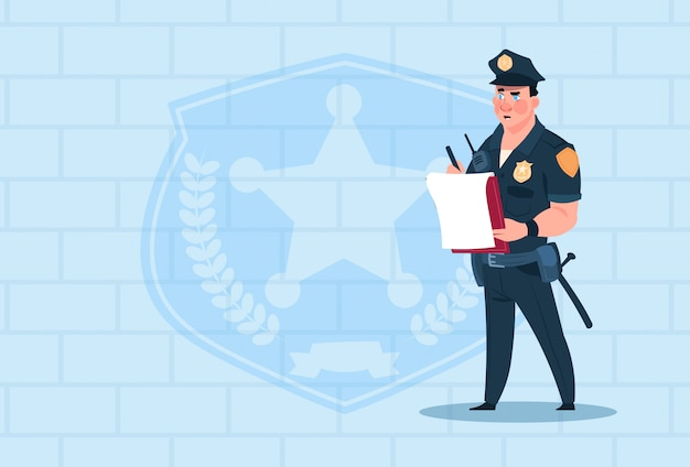 Policeman writing report wearing uniform cop guard over brick background