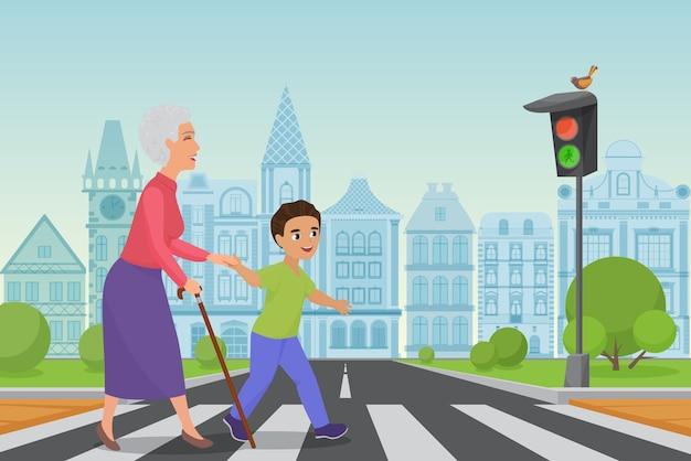 Вежливый мальчик помогает улыбающейся старушке перейти дорогу по пешеходному переходу, пока светит зеленый свет.