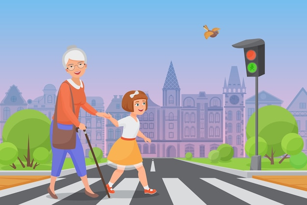Polite little girl helps smiling old woman to pass the road at a pedestrian crossing while the green light shines.
