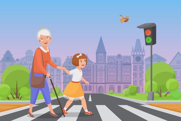 Вежливая девочка помогает улыбающейся старушке перейти дорогу по пешеходному переходу, пока светит зеленый свет.