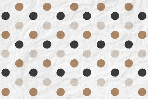 Polka dot pattern in black and gold on crumpled paper textured background