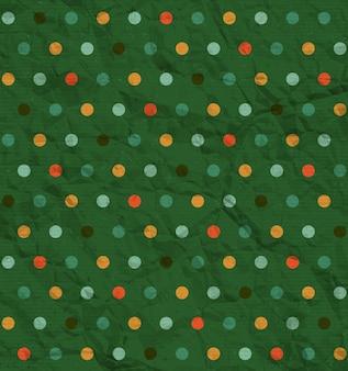 Бесшовный узор в горошек на зеленой ткани