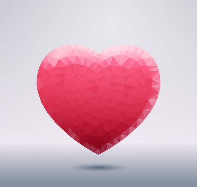 Polygonal pink heart shape isolated with shadow abstract love symbol
