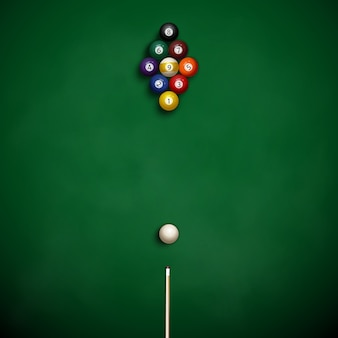 Pool table with balls on the cloth.