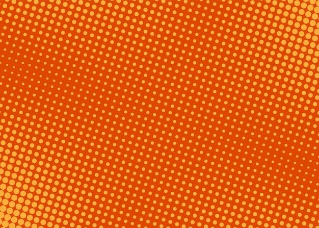 ポップアートの背景。ハーフトーンコミックドットパターン。丸でオレンジ色のプリント。漫画のヴィンテージの質感