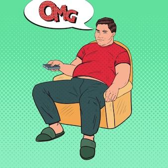 ポップアート退屈ファットマンリモコンでテレビを見ている