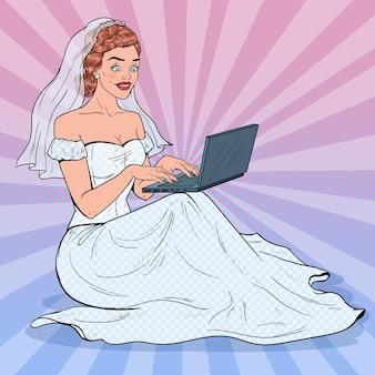 노트북과 팝 아트 신부. 웨딩 드레스 온라인 쇼핑에 행복 한 여자입니다.