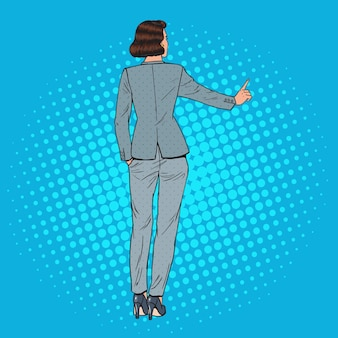 Pop art business woman pressing imaginary virtual button