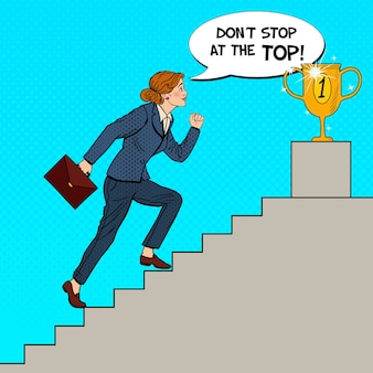 Pop art business woman walking up stairs to golden cup.