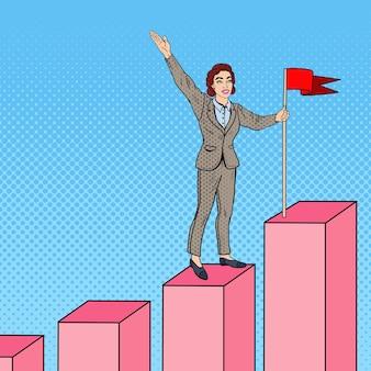 グラフの上にフラグを持つポップアートビジネス女性。