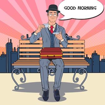 Pop art businessman drinking tea on the morning