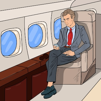 Pop art businessman flying airplane and texting message on cellphone.