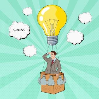 成功を求めて熱気球を飛んでいるポップアートのビジネスマン。