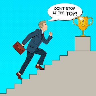 Pop art businessman walking up stairs to golden cup.