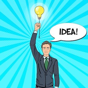 電球のアイデアを持つポップアート実業家。