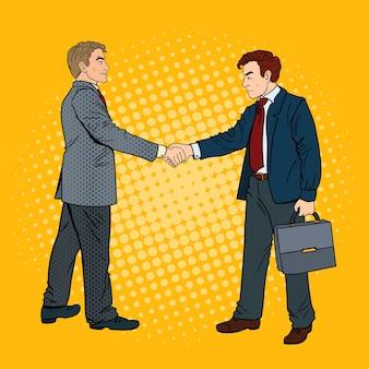 ポップアートビジネスマン握手ビジネス契約。