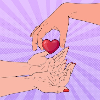 Pop art charity organ donation concept. hand giving heart. health care, medicine.