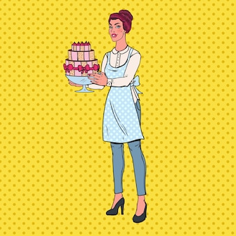 Pop art chef with delicious cake. housewife holding tasty dessert.
