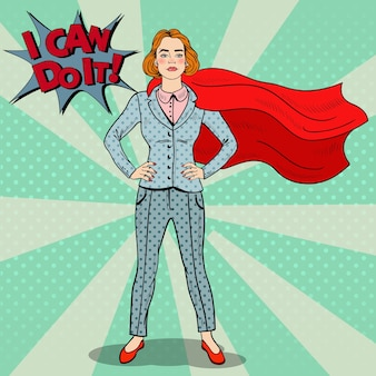 Pop art confident business woman super hero in suit with red cape.