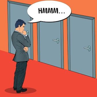 Pop art doubtful businessman choosing the right door.