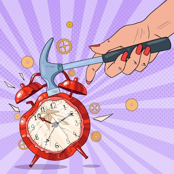 Pop art female hand holding hammer and broking alarm clock.