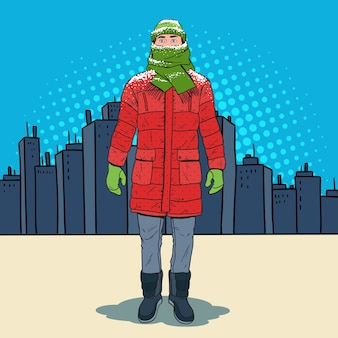 Pop art frozen man in warm winter clothes in the city. cold weather.