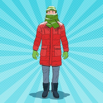 Pop art frozen man in warm winter clothes. cold weather.