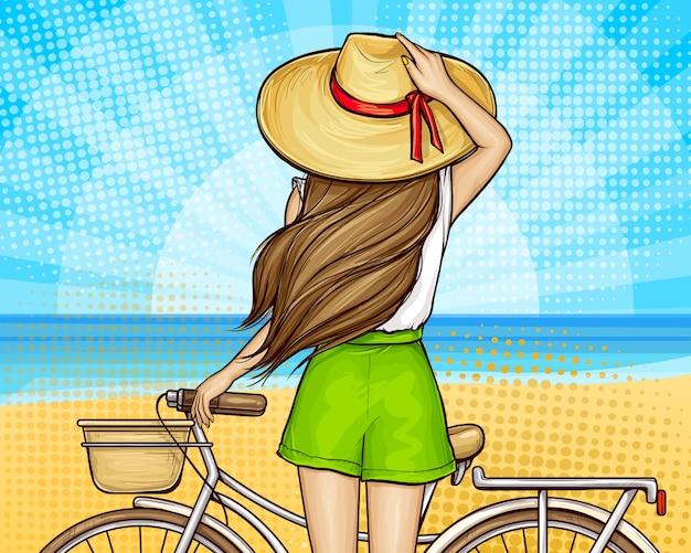 Поп-арт девушка на пляже с велосипедом