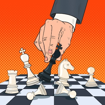 Pop art hand of businessman holding chess figure. business strategy concept.