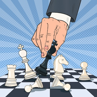Pop art hand of businessman playing chess. business strategy concept.