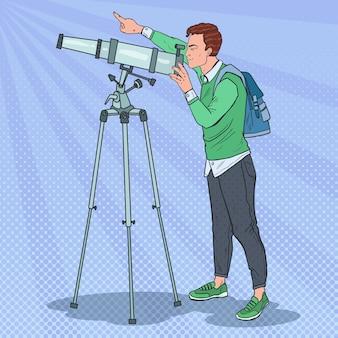 Pop art happy man looking through a telescope
