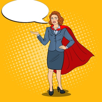 Pop art happy super business woman in red cape pointing on copy space