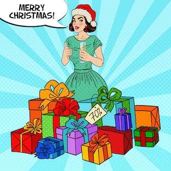 Pop art happy woman in santa hat with big gift boxes and champagne glass.