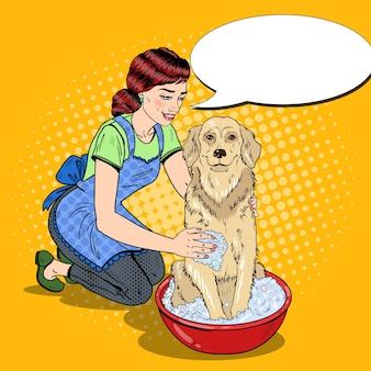 Поп-арт счастливая женщина стирает лабрадора