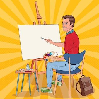 スタジオでのポップアート男性アーティストの絵画。ワークショップの男の画家。