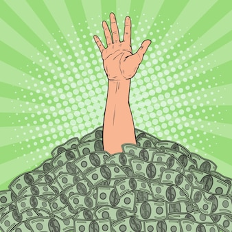 Pop art male hand drowns in pile of money. financial success concept.