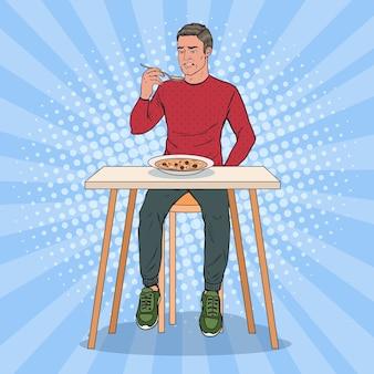 Поп-арт человек ест суп с отвратительным лицом. безвкусная еда.