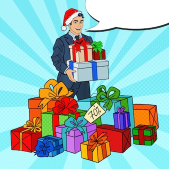 Pop art man in santa hat with gifts on christmas sale.
