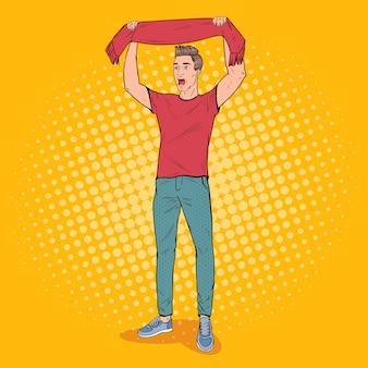 Футбольный болельщик поп-арт человек с шарфом любимой команды