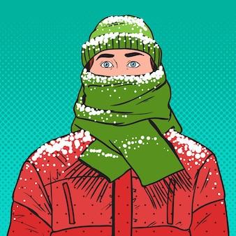 Pop art portrait of frozen man in warm winter clothes. cold weather.