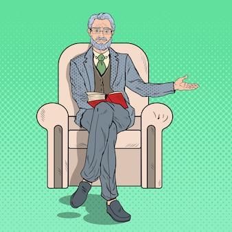 Поп-арт старший бизнесмен, сидя в кресле и указывая копией пространства