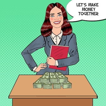 Pop art smiling business woman standing behind the table with money.