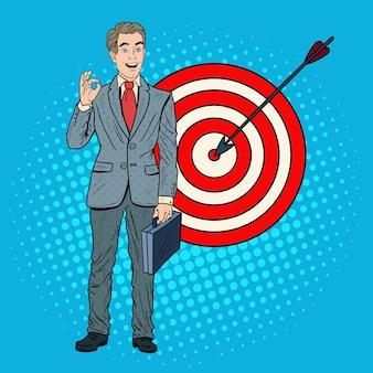 Поп-арт успешный бизнесмен достиг цели. успех в бизнесе.