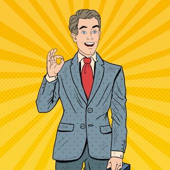 Поп-арт успешный бизнесмен жестами ок. успех в бизнесе.