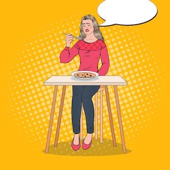 嫌な顔でスープを食べるポップアートの女性。味のない食べ物。
